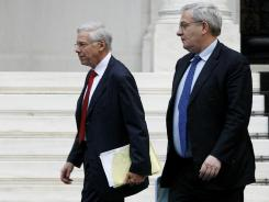 Creditor representatives Charles Dallara and Jean Lemierre leave the Greek prime minister's office Saturday.