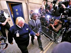 Former UBS trader Kweku Adoboli, center, leaves London's magistrates court in September.