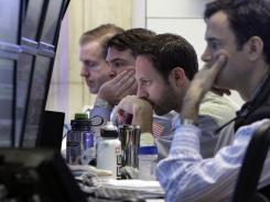 Traders work on the floor of the New York Stock Exchange Jan. 30, 2012.