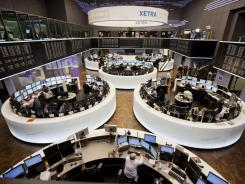 Stock traders work at the Deutsche Boerse in the German city of Frankfurt am Main Feb. 1, 2012.