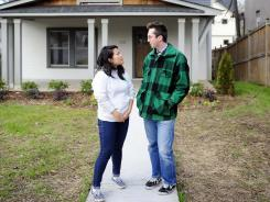 Herrie Son and Kyle Komline look at an a Nashville home for sale. Herrie's parents are helping her with the downpayment.