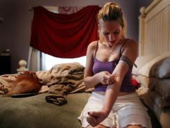 Bree Saghy, 24, injects liquefied oxycodone pills at her Fort Lauderdale, Fla., home in June 2011. Addicted to painkillers for eight years and once a cheerleader, Saghy is a stripper living with her mom and getting drugs legally at local pain clinics.
