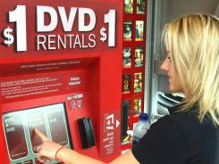 A customer uses a Redbox kiosk.