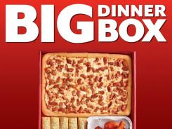 Pizza Hut's Big Dinner filled with two medium rectangular one-topping pizzas, eight wings and five breadsticks. Pizze Hut is owned by Yum Brands, which reported earnings on Feb. 6, 2012.