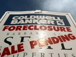 A foreclosed house with sale pending sign in this 2011 photo from Tigard, Ore. A source said more states will sign a settlement with lenders over foreclosure practices.