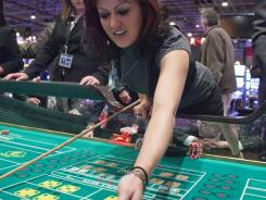Alissa Lott works the craps table at the Kansas Star casino near Mulvane, Kan., which opened Dec. 26, 2011.