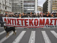 A banner reads ''We resist'' carried by electricity company employees during a protest against the Greek government's plans to privatize part of the power distribution service.