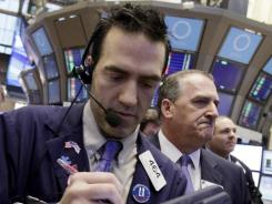 ITraders busy on the floor of the New York Stock Exchange on Feb. 8, 2012.