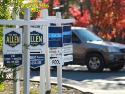 For-sale signs at a housing complex in Larkspur, Calif.