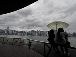 Onlookers observe the skyline of Hong Kong island.