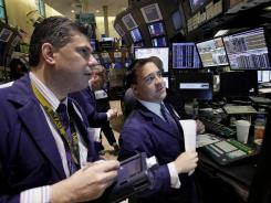 Stock specialists at their posts on the floor of the New York Stock Exchange on Feb. 1, 2012.