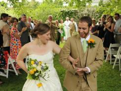 Mary McNergney and Kevin Fitzpatrick at their wedding in Charlottesville, Va.. The average wedding costs $26,501.