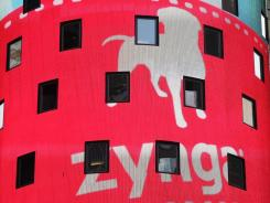 The corporate logo for Zynga is shown on an electronic billboard at the Nasdaq MarketSite in New York City on its first trading day, Dec. 16, 2011.
