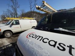 Comcast service vehicles parked at a Comcast facility in Pittsburgh, on Feb. 13, 2012.