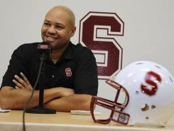 Stanford head football coach David Shaw smiles during a Feb. 1, 2012, news conference on the Stanford University campus in Palo Alto, Calif., about the university's new football recruits.