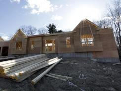 A new single-family house goes up in North Andover, Mass., in January 2012.