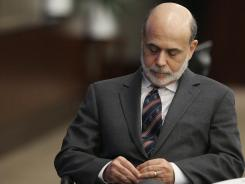 Chairman of the Federal Reserve Ben Bernanke listens to his introduction before speaking at the Federal Deposit Insurance Corporation headquarters, in Arlington, Va., on Feb. 16, 2012.