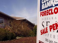A foreclosed house with sale pending sign in Tigard, Ore., in March 2011.