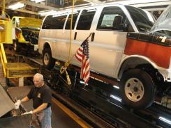 A General Motors employee works on a van assembly line at GM's plant in Wentzville, Mo. in November.