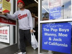 Customer leaves a Pep Boys - Manny, Moe & Jack auto parts store in Hayward, Calif.