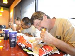 Rob Lopez, Jose Acosta and Ivan Barajas try the new Doritos Tacos at Taco Bell.