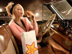 'Sports Illustrated' swimsuit cover model Kate Upton is featured in new ads for fast food chain Carl's Jr. and Hardee's.