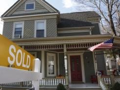 A sign proclaims a residential home sale in Marborough, Mass. in November.