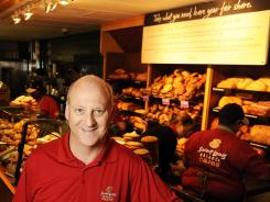 Panera CEO Ron Shaich at the opening of the Panera Cares Cafe in Clayton, Mo., in 2010. The big sign says 'Take what you need, leave your fair share.'