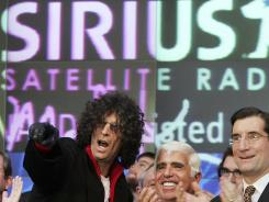 Radio personality Howard Stern, Sirius CEO Mel Karmazin and Nasdaq CEO Robert Greifeld preside over the NASDAQ opening bell in January 2006.