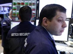 Traders work on the floor at the New York Stock Exchange on Feb. 23, 2012.