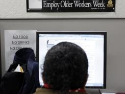 A job seeker peruses job opportunities at JobTrain employment center in Menlo Park, Calif., on Feb. 14, 2012.