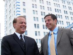 Dennis Gomes, left, a co-owner of Resorts Casino Hotel, and son Aaron, a casino exec, in July in Atlantic City.