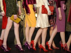 Models walk the runway Feb. 16 at the L'Wren Scott Fall 2012 fashion show during Mercedes-Benz Fashion Week in New York.