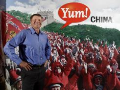 David Novak, CEO of Yum Brands, by a poster at corporate headquarters in Louisville.