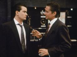 "Charlie Sheen, left, and Michael Douglas in a scene from the 1987 movie ""Wall Street."""