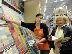Sarah Smith helps customer Heidi Deluca choose a color of Martha Stewart Living paint at Home Depot in Fairfax, Va. Martha Stewart's brand expanded into home office supplies at Staples earlier this month.