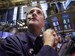 Trader Jonathan Corpina works on the floor of the New York Stock Exchange on Feb. 24, 2012.