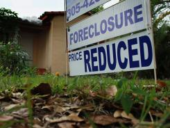 A foreclosure sign in front of a Miami home.