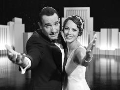 "Jean Dujardin portrays George Valentin, left, and Berenice Bejo portrays Peppy Miller in a scene from ""The Artist,"" which won Best Picture this year at the 84th Academy Awards on Feb. 26, 2012, in Los Angeles."