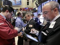 Traders on the floor of the New York Stock Exchange on Feb. 27, 2012.