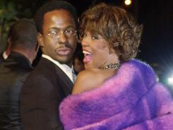 "Whitney Houston and then-husband Bobby Brown at the March 2001 ""Vanity Fair"" Oscar party in Hollywood."