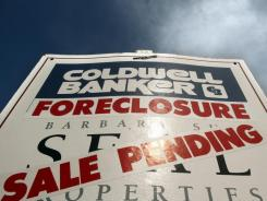 A foreclosed sale pending sign in Tigard, Ore.