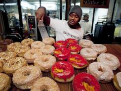 Christian Djomatin works at the Dough bakery in Brooklyn, N.Y., on Feb. 24, 2012. The number of people seeking unemployment benefits fell last week to the lowest point in four years.