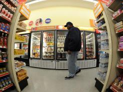 Jeremiah Beale of Fredericksburg, Va., shops in the Family Dollar store. Family Dollar learned that if they offer food in a freezer section, their customers buy more food items elsewhere in the store.