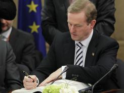 Ireland Prime Minister Enda Kenny signs the Treaty on Stability, Coordination and Governance in the Economic and Monetary Union March 2, 2012 at EU headquarters in Brussels.