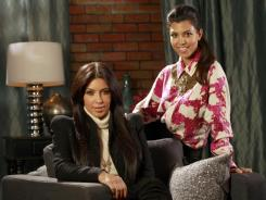 """Kourtney Kardashian, with sister Kim, at left, showed her appreciation of couponing in an episode of TV's """"Kourtney & Kim Take New York."""""""