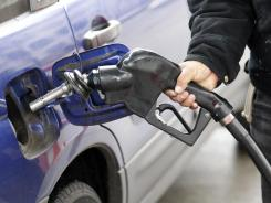 An attendant pumps gasoline in Portland, Ore., in February 2012.