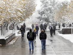 Students walk on Denver's Auraria Campus in 2011.