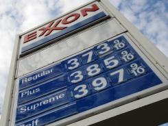 This Feb. 27, 2012, photo of a sign for gas prices at a Pittsburgh Exxon mini-mart.