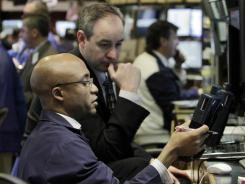 Traders on the floor of the New York Stock Exchange on Feb. 24, 2012.